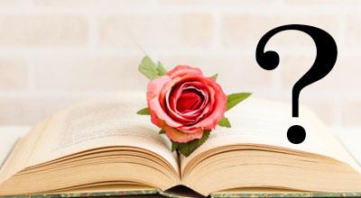 薔薇と本にクエスチョンマークが浮かんでいる